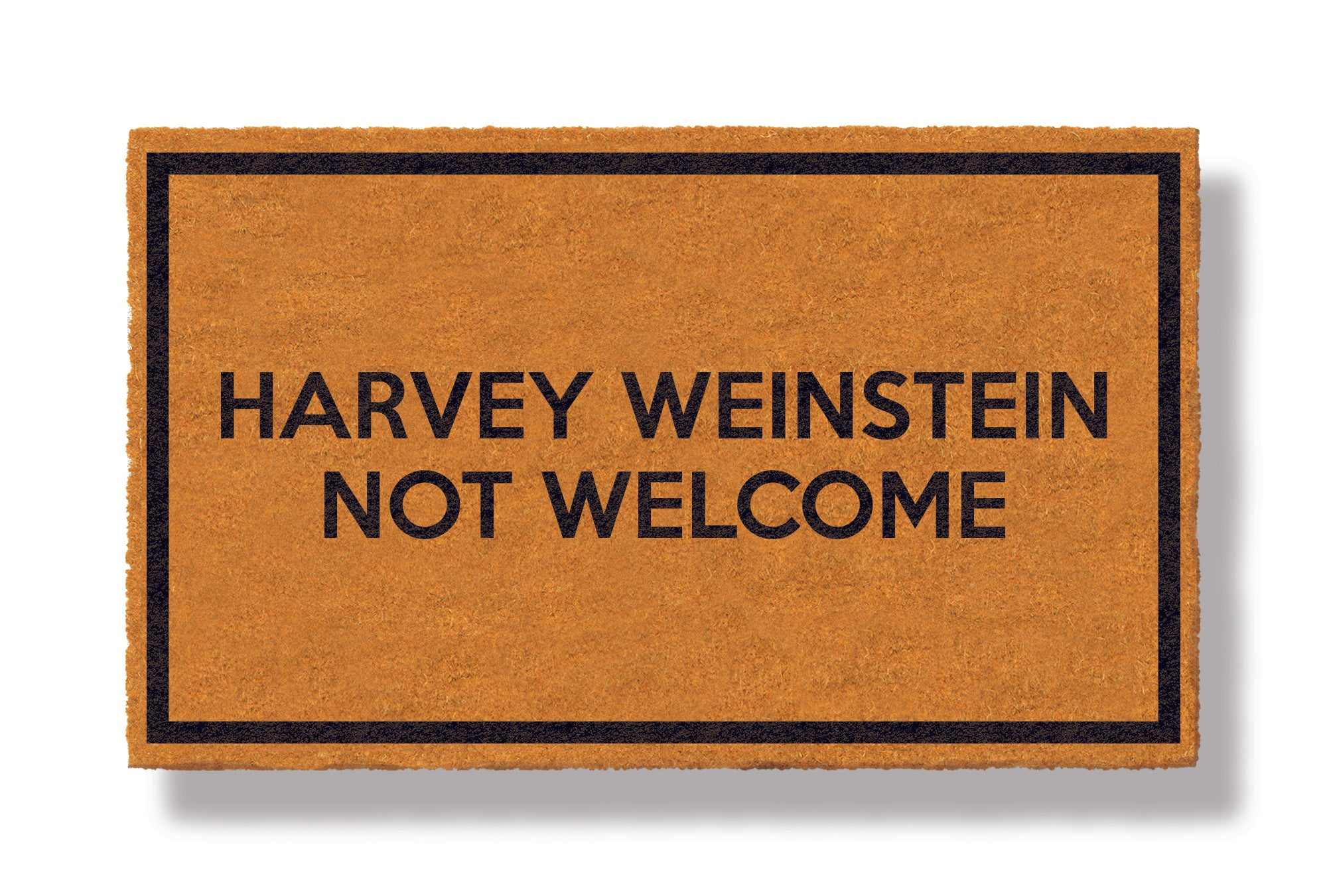 This coir welcome mat is a funny doormat on a white background with a drop shadow. The brown doormat has a black border and has black centered text that reads Harvey Weinstein Not Welcome.