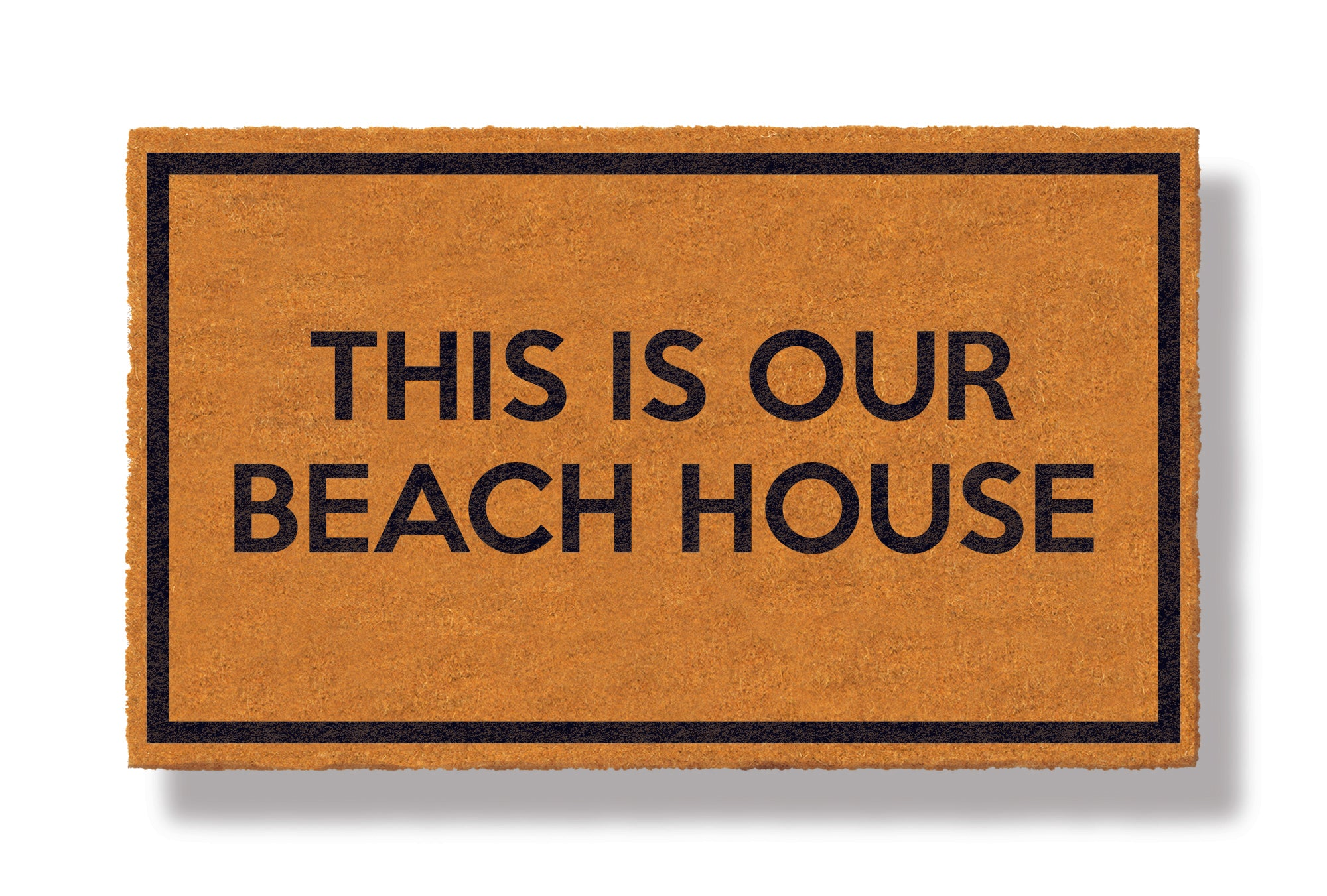 This coir welcome mat is a funny doormat on a white background with a drop shadow. The brown doormat has a black border and has black centered text that reads This Is Our Beach House.