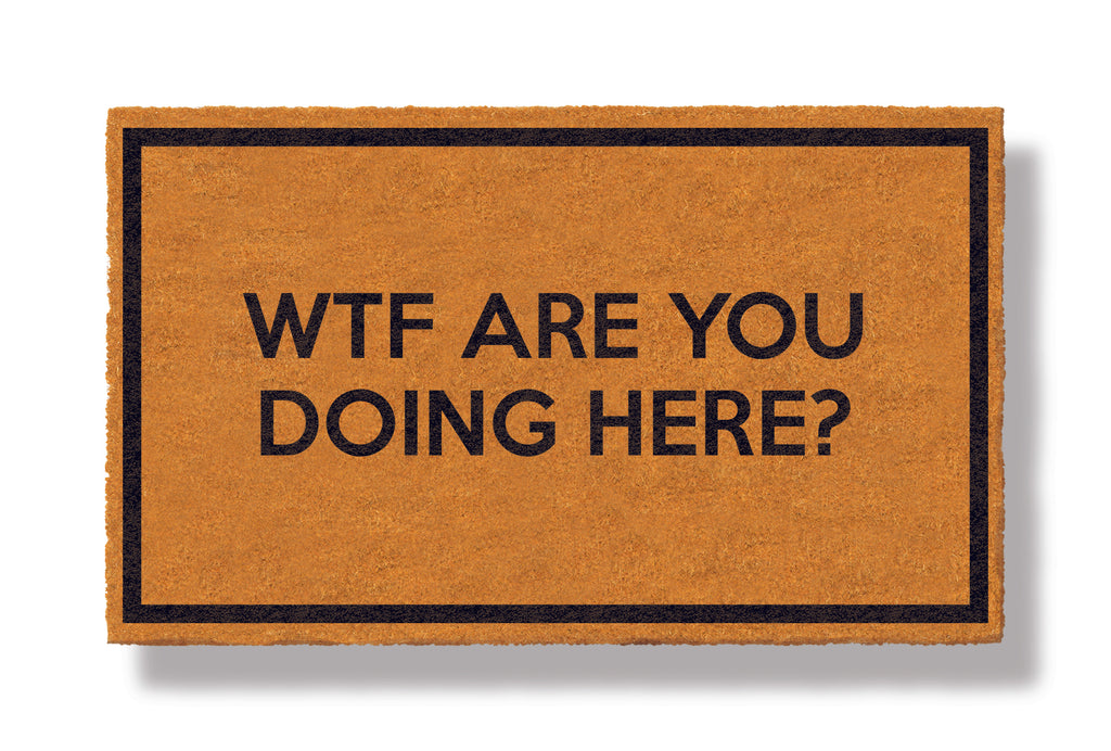 This coir welcome mat is a funny doormat on a white background with a drop shadow. The brown doormat has a black border and has black centered text that reads WTF Are You Doing Here?