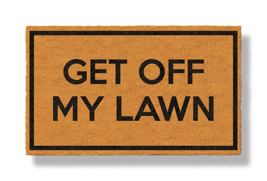 This coir welcome mat is a funny doormat on a white background with a drop shadow. The brown doormat has a black border and has black centered text that reads Get Off My Lawn.