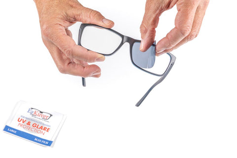 eykuver film being applied to glasses