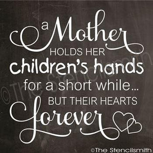 3190 - A mother holds her children's hands