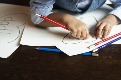 kids-coloring-on-notebook