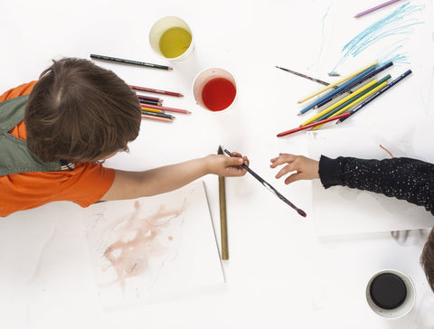 kids-painting-on-large-size-drawing-paper
