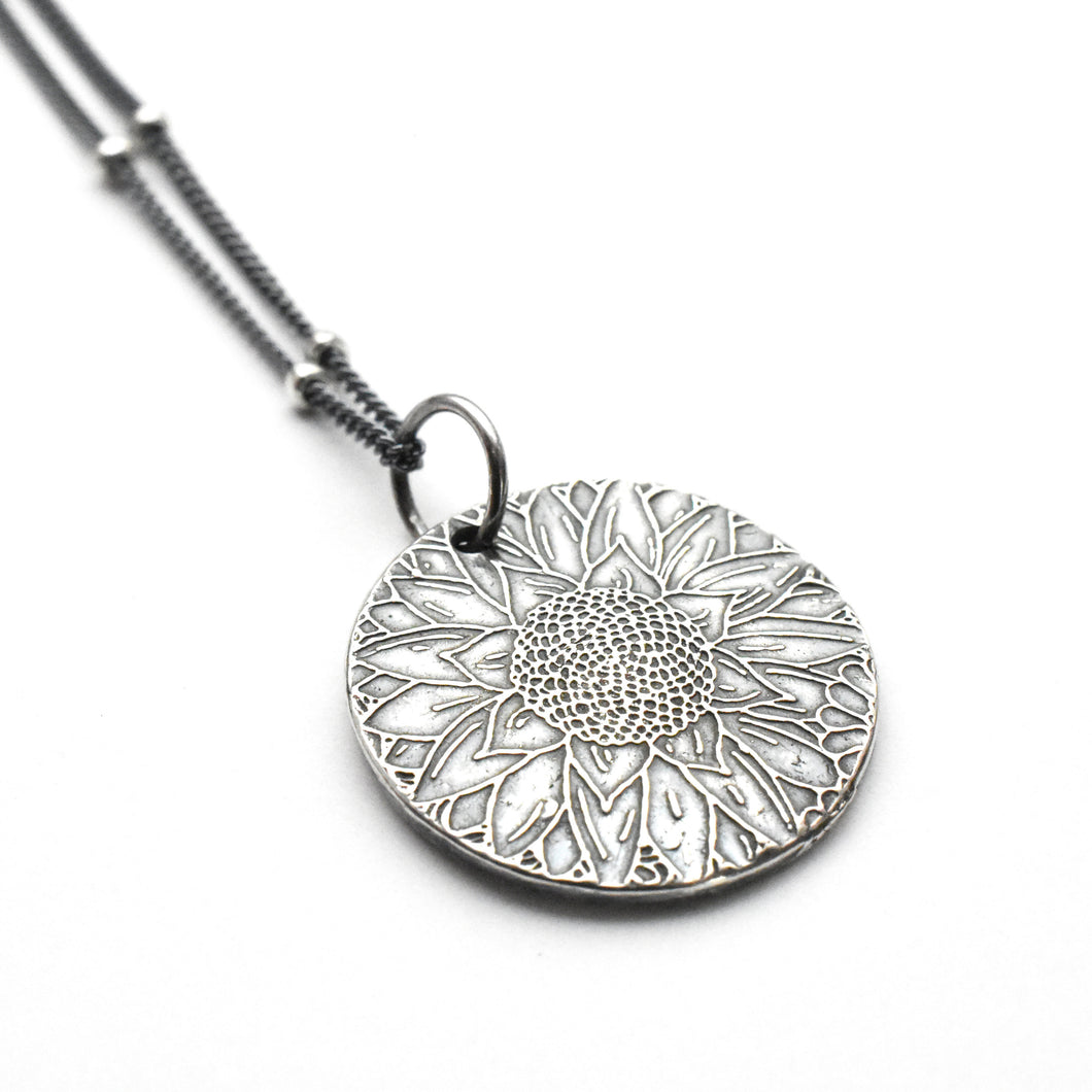Silver Pendant Necklace with Stamped Sunflower Design
