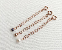 Load image into Gallery viewer, Jewelry Extender in 14k Rose Gold Fill with White Freshwater Pearl Charm. Perfect for Layered Necklaces, Bracelets or Anklets