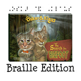 "Oskar & Klaus: The Search for Bigfoot Book Cover. It states ""Braille Edition"" below the book cover. Image also features Braille dots above the book cover that read ""Oskar & Klaus"" in braille. The cats stand on the cover looking courageous and brave. A shadowy figure can be seen in the hazy wooded background. A wooden sign reads ""The Search for Bigfoot""."