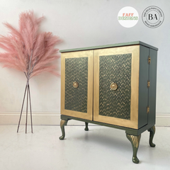 green cabinet with faux pink flowers