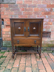antique oak cabinet with drawer
