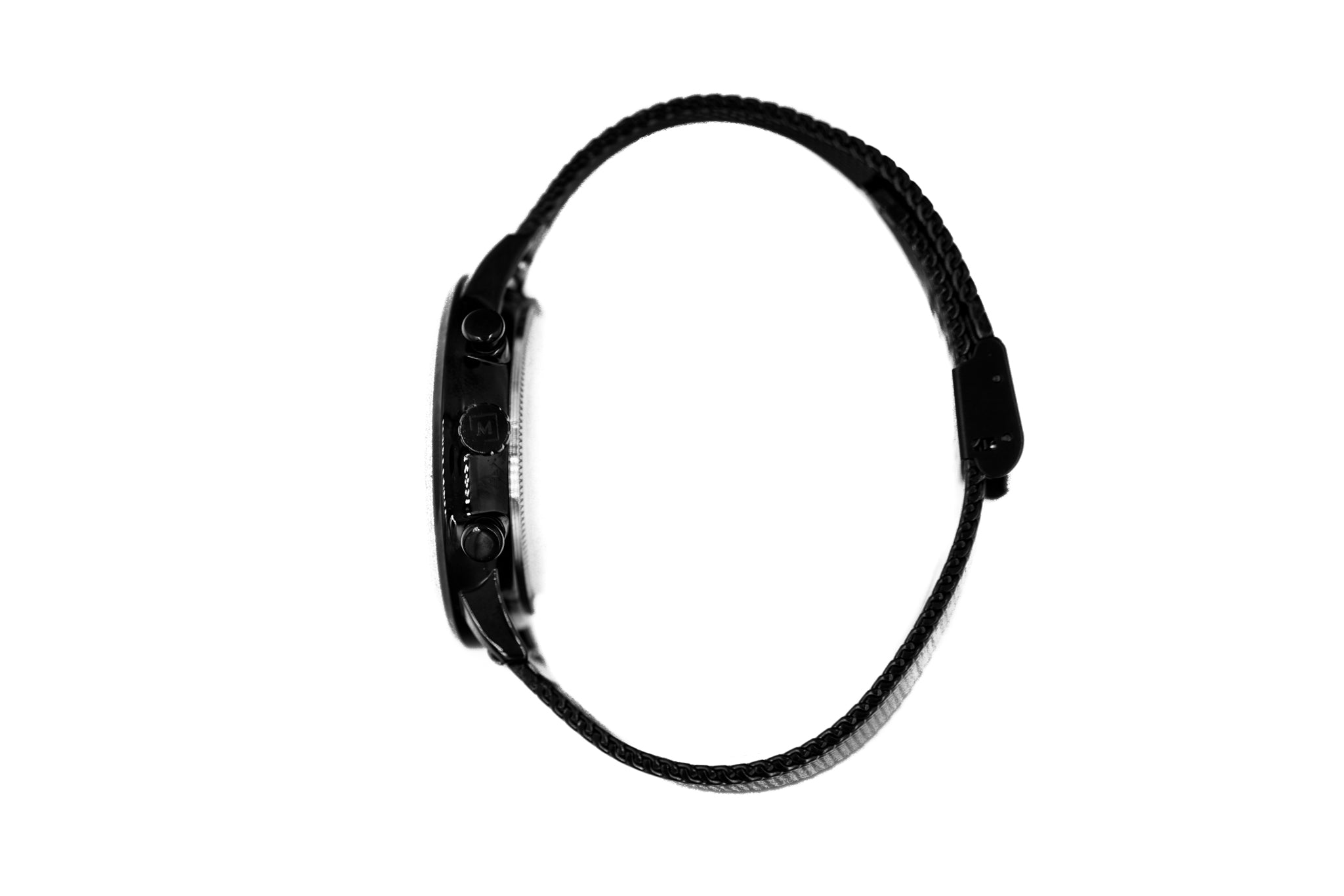 Black watch called Baku from the brand Montreville, seen from the side. This is an image of the watch with a white background. The timepiece has a unique design with a mesh strap in black.