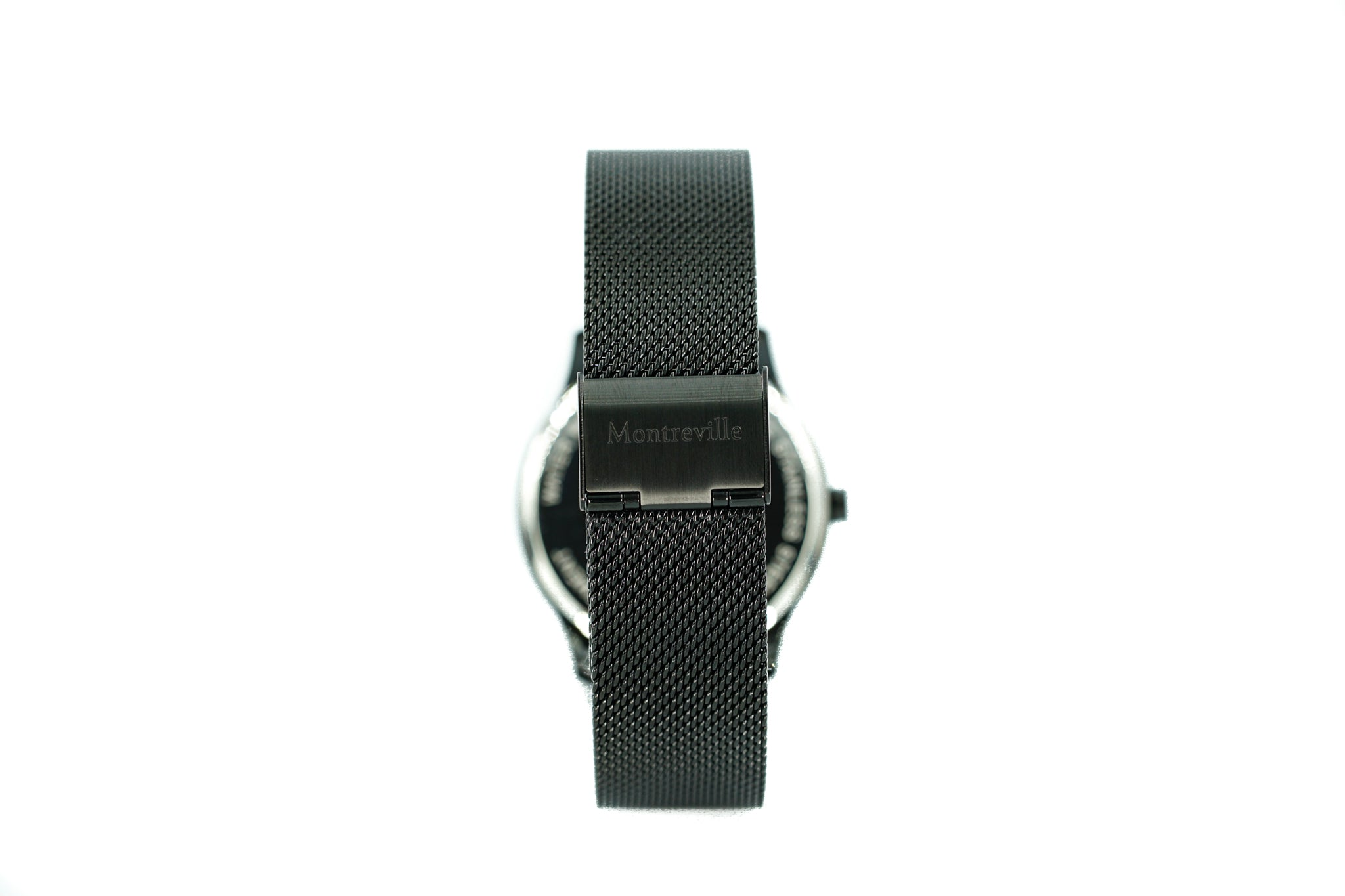 Black watch called Houston from the brand Montreville, seen from the back. This is an image of the watch with a white background. The timepiece has an elegant design with a mesh strap in black.