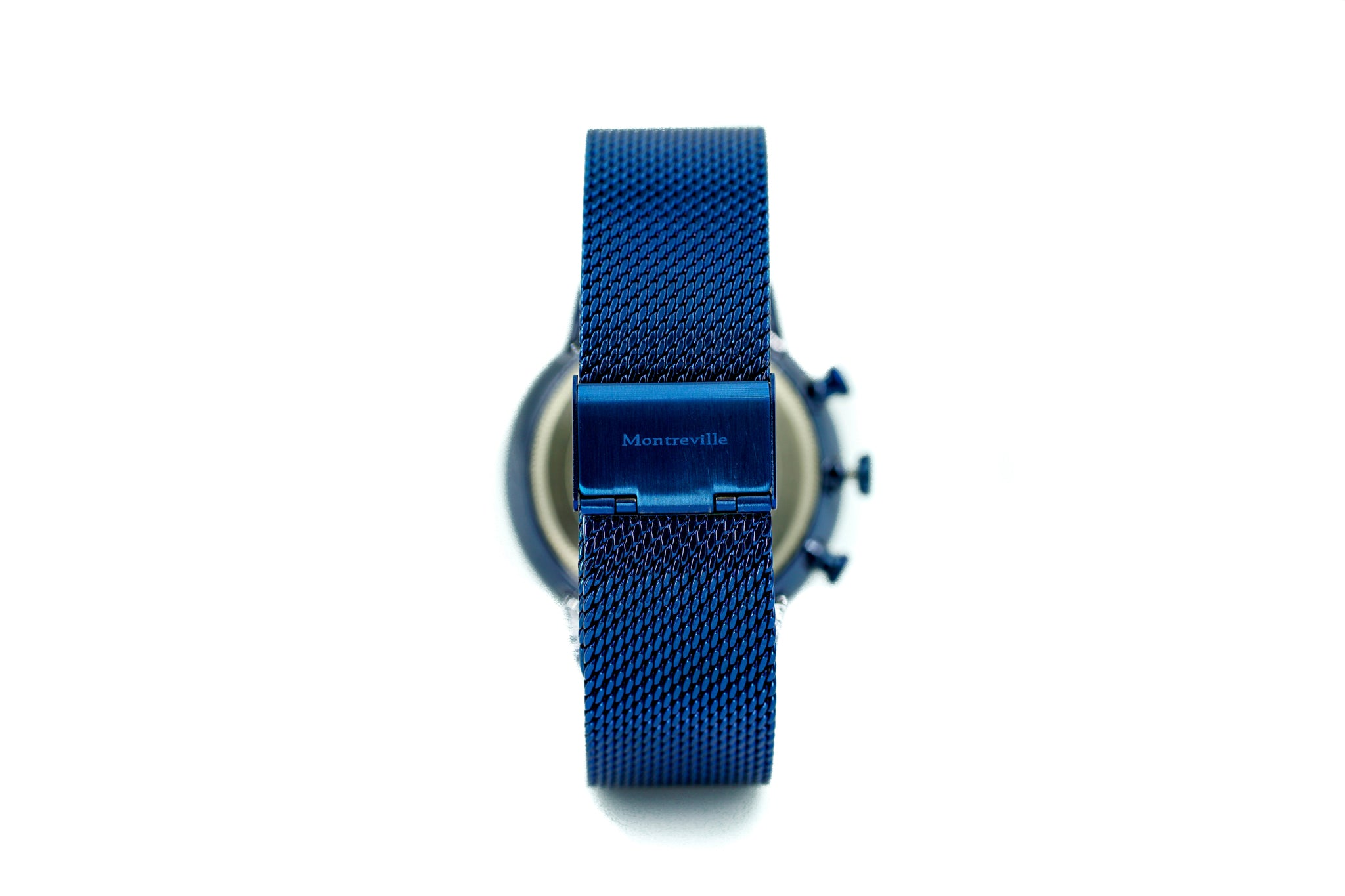 Blue watch called Jodhpur from the brand Montreville, seen from the back. This is an image of the watch with a white background. The timepiece has a unique design with a mesh strap in blue.