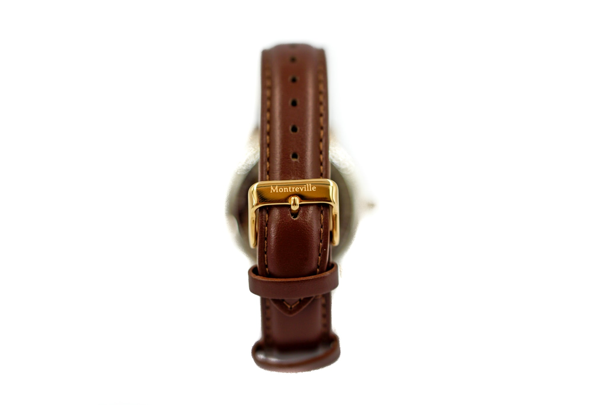 Brown watch called Oslo from the brand Montreville, seen from the back. This is an image of the watch with a white background. The timepiece has an elegant design with a dark brown leather strap.
