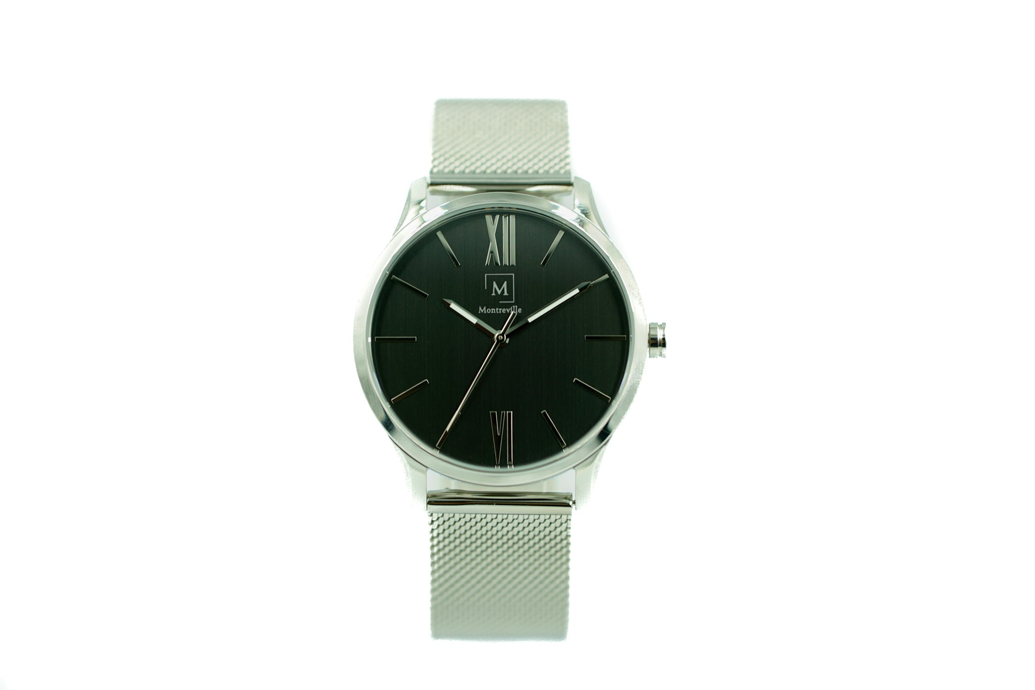 Silver watch called Tokyo from the brand Montreville. This is an image of the watch with a white background. The timepiece has an elegant design with minimalistic lay-out. It has roman numerals in silver and a mesh strap in silver.