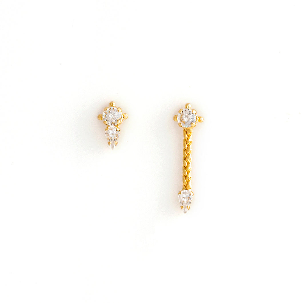 Gold asymetrical stud earrings by ESTRELA