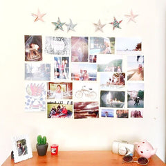 Recycled paper star bunting decorating a wall