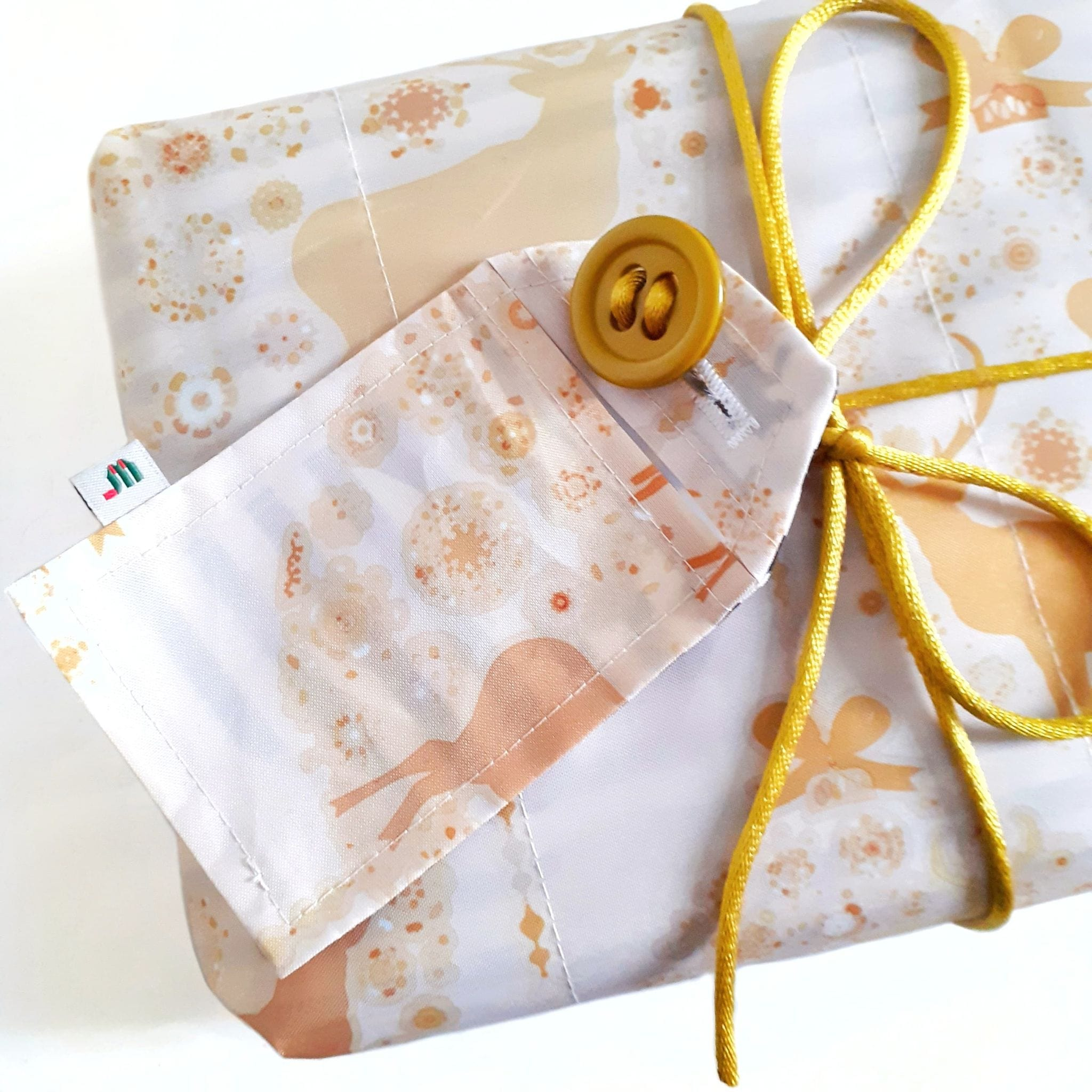 Earth Friendly Reusable Wrapping Paper - Sustainer Container