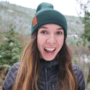 Callie wearing green adventure beanie