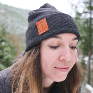 Callie wearing charcoal adventure beanie