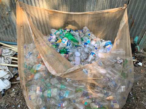 Aggregated plastic bottles ready to be sorted and sold to recycling companies