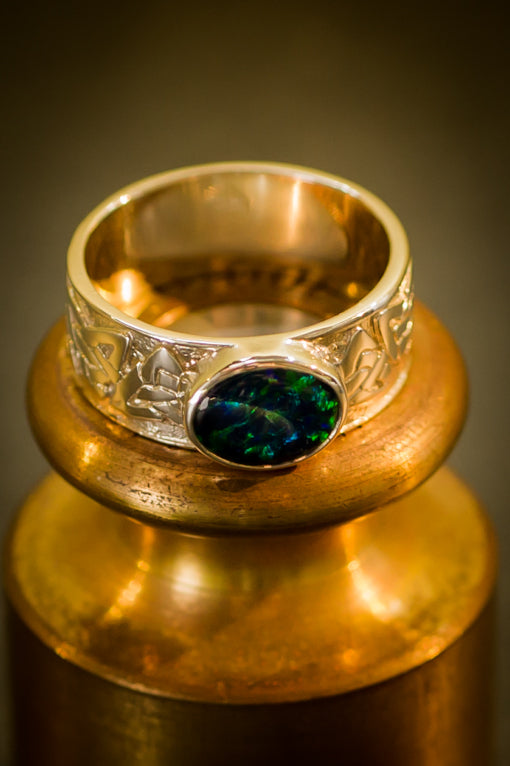 gold & opal celtic ring