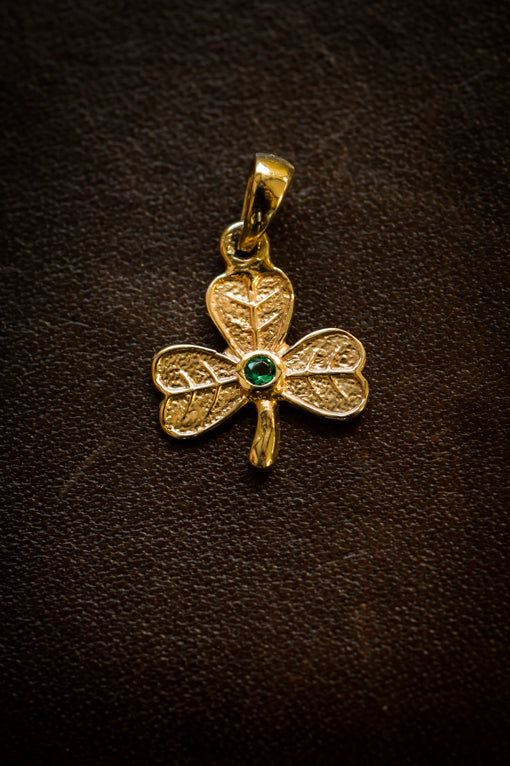 gold shamrock pendant with emerald