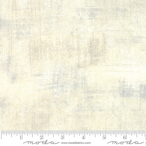 Cream grunge fabric with grey and taupe accents