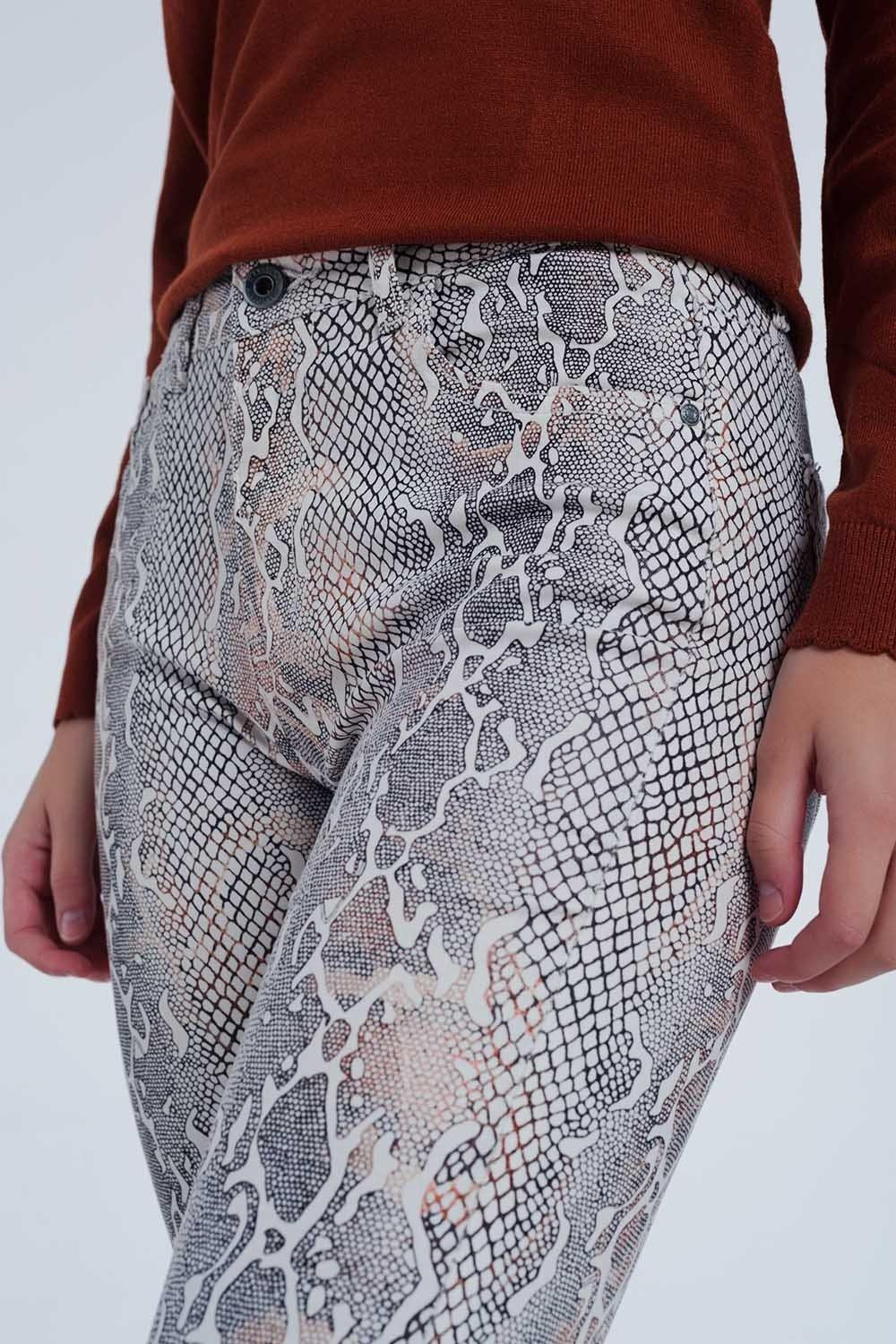 Q2 beige coloured pants with snake print