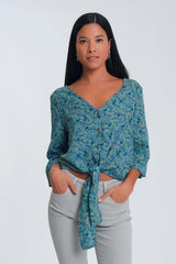 Q2 Long sleeve v neck blouse with button detail in green floral print