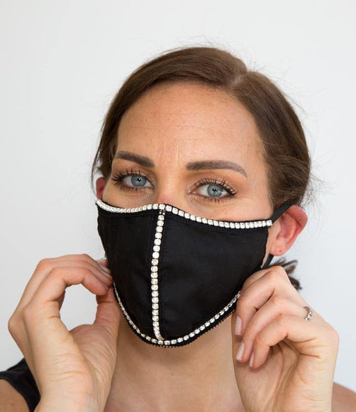 Stop traffic in our 99% HEPA barrier Eva rhinestone fashion face mask. The outer layer and lining is made of 100% breathable, washable Cotton. A nose grip is included for the perfect fit. For maximum protection the premium grade rhinestones are attached to the outer fabric layer only.
