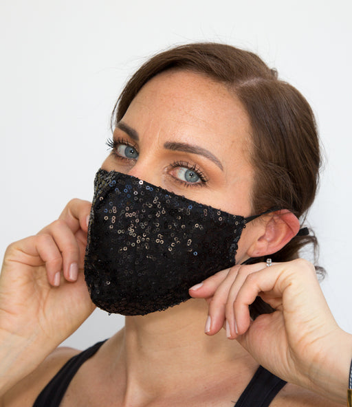 Our Add sparkle to your life with this beauty. Our Cynthia HEPA 99% barrier sequin face mask is the perfect add-on to your closet. Made of sequin outer layer, 100% soft cotton lining and a nose grip. The comfortable inner lining and soft fabric adjustable elastic straps makes it a fun yet stylish mask for every occasion. Dress up any outfit with these beauties