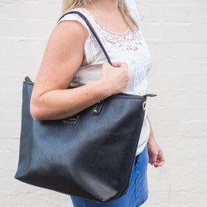 lady wearing a black corporate nappy bag