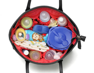 open view of a nappy bag full of baby items