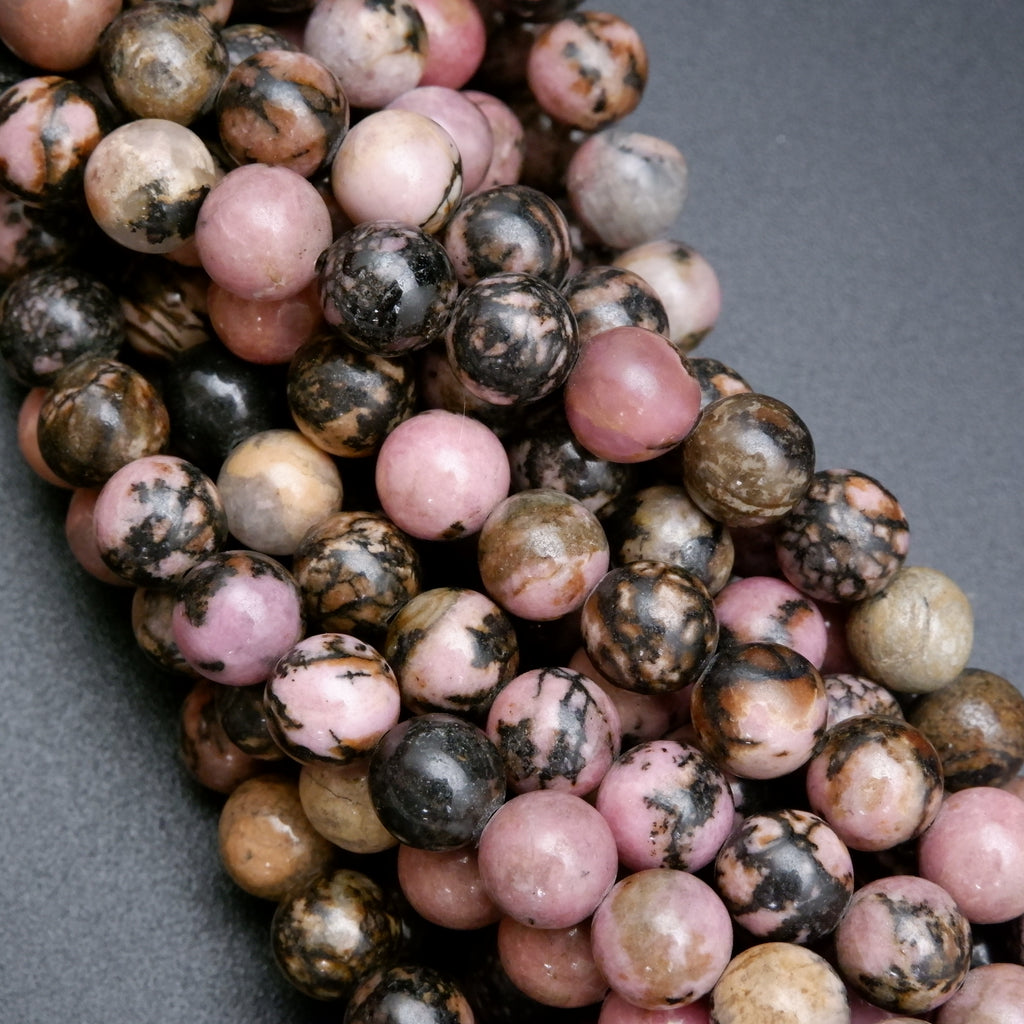 Round natural rhodonite beads with high polish finish.