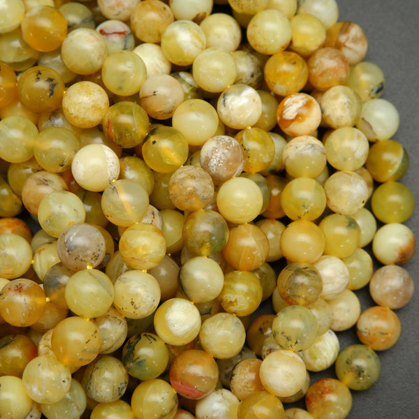 Round african yellow opal beads for jewelry making. Loose opal beads on a string.