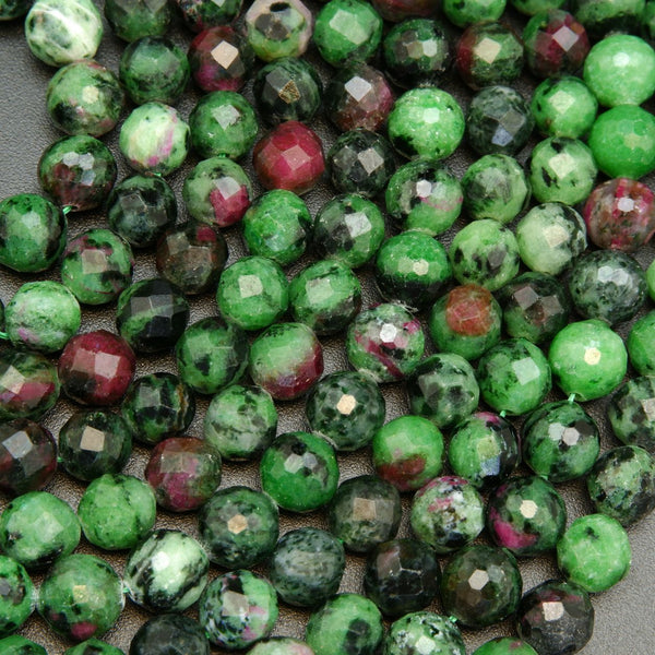 Green and purple faceted  ruby zoisite beads.