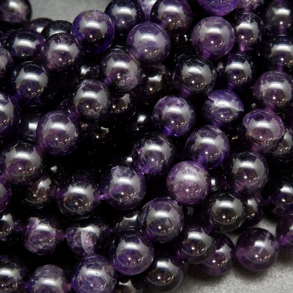 Natural round purple amethyst beads.
