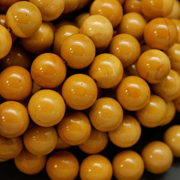 Round yellow beads for jewelry making. Australian Yellow Mookaite loose beads.