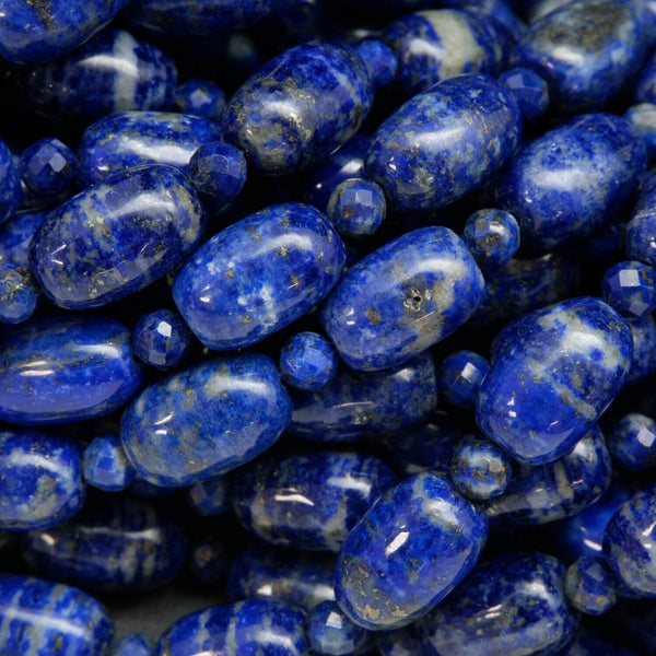 Polished Finish lapis lazuli barrel shape beads with round faceted spacers between. Loose beads on a string for jewelry making.