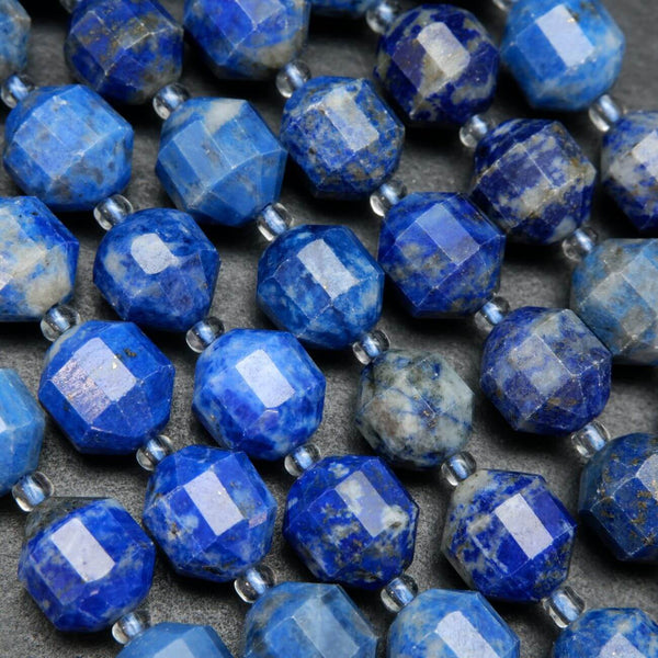 Blue marbled faceted prism shape lapis lazuli beads.