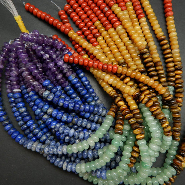 Purple, Blue, Green, Brown, Yellow, and Red Seven Chakra Rondelle Loose Beads.