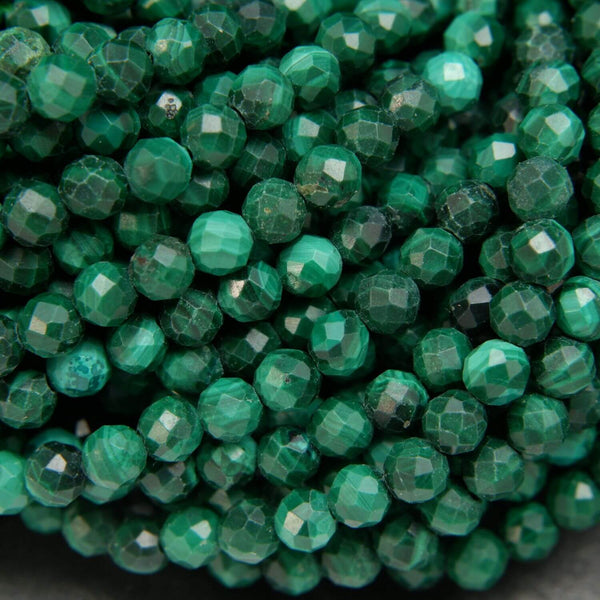 Light and dark green malachite beads. Round shape with faceted finish.