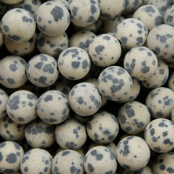 Beige to tan color matte finish Dalmatian Jasper beads. Round matte finish beads with black spots.