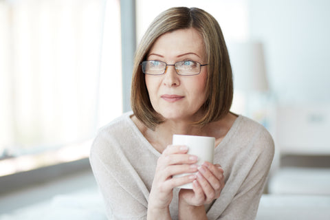 Woman holding a cup of tea