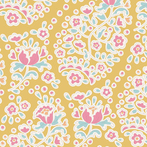 Tilda Happy Camper Charlene Honey quilt fabric with floral shaped pink paisley on a golden yellow background