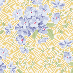 Tilda Happy Campers Primrose Eggnog quilt fabric with purple blossoms on a soft yellow background