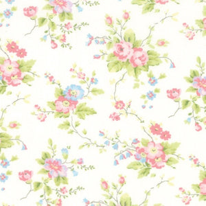 Finnegan Linen Floral quilt fabic with pink and blue floral clusters on an ivory background by Brenda Riddle for Moda