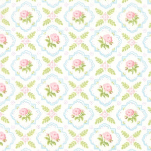 Finnegan Linen Trellis quilt fabric with small pink flowers framed in blue with green leaves on an ivory background by Brenda Riddle for Moda