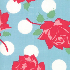 Cheeky Swell Blue Raspberry fabric with large red roses and big white polka dots on a light blue background by Urban Chiks for Moda