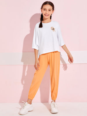 Girls Raglan Sleeve Letter Graphic Stepped Hem Top & Pants Set